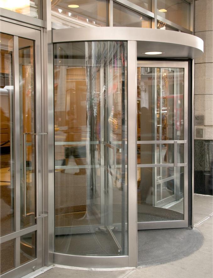 Puertas autom ticas de cristal para centros comerciales for Puerta giratoria